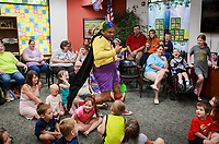 NWA Democrat-Gazette/CHARLIE KAIJO Magician Tommy Terrific performs during a magic show, Thursday, July 5, 2018 at the Bella Vista Public Library in Bella Vista. <br /><br />Tommy Terrific performed a musical magic show for youth.