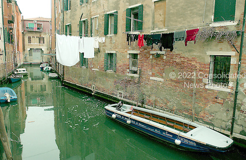 "Venice, Italy - March 24, 2006 --  Canal scene near the Jewish ""Ghetto"" in Venice, Italy on March 24, 2006.  There are personal boats parked along the side of the canal and laundry hanging over the canal from individual apartments..Credit: Ron Sachs / CNP"