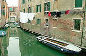 """Venice, Italy - March 24, 2006 --  Canal scene near the Jewish """"Ghetto"""" in Venice, Italy on March 24, 2006.  There are personal boats parked along the side of the canal and laundry hanging over the canal from individual apartments..Credit: Ron Sachs / CNP"""