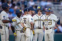Michigan Wolverines assistant coach Nick Schnabel (23) talks with the team during a break against the Vanderbilt Commodores during Game 1 of the NCAA College World Series Finals on June 24, 2019 at TD Ameritrade Park in Omaha, Nebraska. Michigan defeated Vanderbilt 7-4. (Andrew Woolley/Four Seam Images)