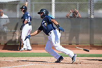 Milwaukee Brewers catcher Luis Avalo (97) starts down the first base line during an Instructional League game against the Los Angeles Dodgers at Maryvale Baseball Park on September 24, 2018 in Phoenix, Arizona. (Zachary Lucy/Four Seam Images)