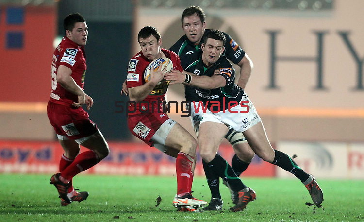 Dave McSharry tackles Adam Warren..RaboDirect Pro12.Scarlets v Connacht.02.03.12.©STEVE POPE