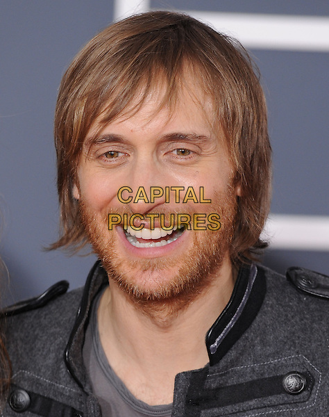 DAVID GUETTA.Arrivals at the 52nd Annual GRAMMY Awards held at The Staples Center in Los Angeles, California, USA..January 31st, 2010.grammys headshot portrait stubble facial hair grey gray .CAP/RKE/DVS.©DVS/RockinExposures/Capital Pictures