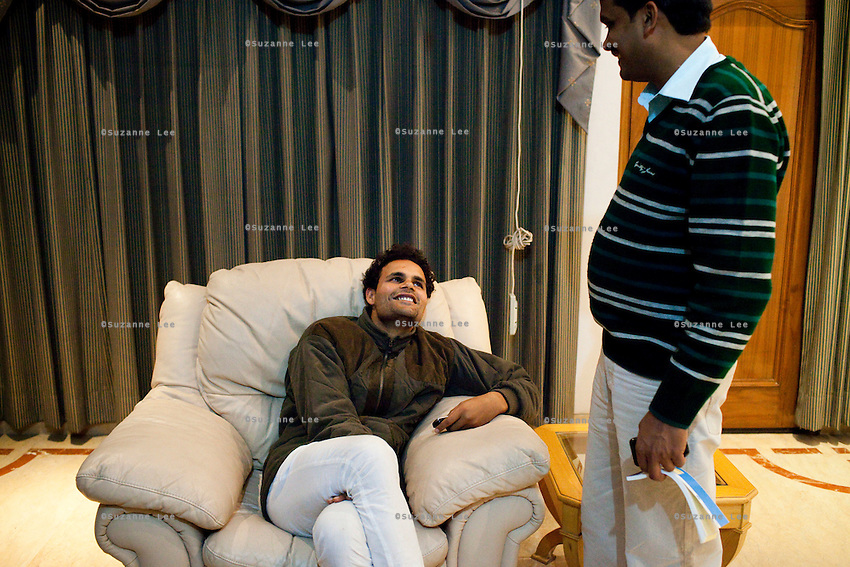 Minister of Legislative Assembly, Ritesh Pandey, 30, speaks with a party worker as he signs cheques at home after campaigning late into the night in Jalalpur constituency in Uttar Pradesh, India, on 20th January, 2012. Returning 1.5 years ago after almost 10 years abroad, Pandey is contesting on behalf of the Bahujan Samaj Party (BSP), a party that is based on its appeal to Dalit (the lowest Hindu caste) voters. Party leader, Mayawati herself is a Dalit but has recently been giving out more tickets to muslims and high caste candidates in an attempt to woo a larger spectrum of voters in Uttar Pradesh, a Bellwether state. Photo by Suzanne Lee for The National (online byline: Photo by Szu for The National)