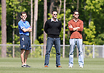 Eric Wynalda (center) with team press officer Michael Kammarman (l) and unknown (r) on Wednesday, May 17th, 2006 at SAS Soccer Park in Cary, North Carolina. The United States Men's National Soccer Team held a training session as part of their preparations for the upcoming 2006 FIFA World Cup Finals being held in Germany.