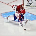 24 September 2009: Montreal Canadiens' goaltender Jaroslav Halak makes a third period stick save against the Boston Bruins at the Bell Centre in Montreal, Quebec, Canada. The Bruins edged out the Canadiens 2-1 after an overtime shootout in a pre-season matchup. Mandatory Credit: Ed Wolfstein Photo