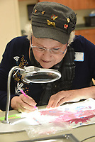 NWA Democrat-Gazette/FLIP PUTTHOFF <br /> ONE BEAD AT A TIME<br /> Victoria Ryan tries her hand Wednesday March 13 2019 at diamond painting during a class at the Rogers Adult Wellness Cneter. The art of diamond painting involves placing minute colored beads on a pre-made pattern to create a picture. It's similar to embroidery, cross stitch and paint by numbers, said Jackie Jackson, teacher. One picture contains hundreds of colored beads. Wednesday was Ryan's first time to try the art form.
