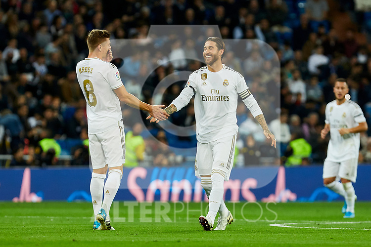 Toni Kroos (L) and Sergio Ramos (R) of Real Madrid celebrate goal during La Liga match between Real Madrid and CD Leganes at Santiago Bernabeu Stadium in Madrid, Spain. October 30, 2019. (ALTERPHOTOS/A. Perez Meca)