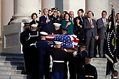 Former President George W. Bush and other family members watch as the flag-draped casket of former President George H.W. Bush is carried by a joint services military honor guard to lie in state in the rotunda of the U.S. Capitol, Monday, Dec. 3, 2018, in Washington. (AP Photo/Alex Brandon, Pool)