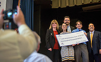STAFF PHOTO JASON IVESTER --12/05/2014--<br /> Melissa Fink (from left), principal; Amber Stout, teacher; Russ Galbraith with Farmers Insurance; Justin Minkel, teacher; and Greg Collier with Farmers Insurance, pose for photos after Stout and Minkel were awarded a $100,000 grant from the Thank a Million Teachers Dream Big Challenge at Jones Elementary School in Springdale. The grant will be utilized to purchase 25,000 books for 1,000 students in three Springdale (including Jones) elementary schools.