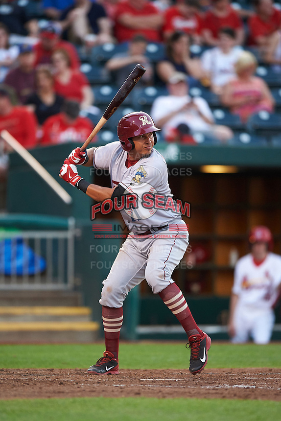 Frisco RoughRiders shortstop Edwin Garcia (11) at bat during a game against the Springfield Cardinals  on June 4, 2015 at Hammons Field in Springfield, Missouri.  Frisco defeated Springfield 8-7.  (Mike Janes/Four Seam Images)