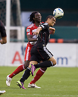 Charlie Davies (9) of D.C. United fights for the ball with Ugo Ihemalu (3) of FC Dallas during the game at RFK Stadium in Washington, DC.  D.C. United tied FC Dallas, 0-0.