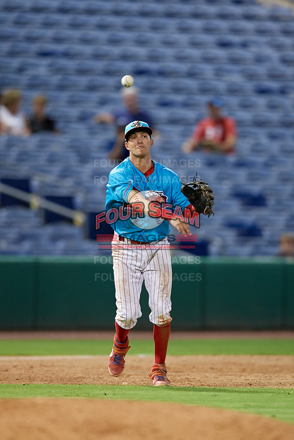 Clearwater Beach Dogs third baseman Dalton Guthrie (46) throws to first base during a Florida State League game against the Charlotte Stone Crabs on July 26, 2019 at Spectrum Field in Clearwater, Florida.  Clearwater defeated Charlotte 6-5.  (Mike Janes/Four Seam Images)
