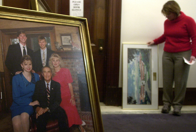 Strom13/121802 - Becky Fleming, Press Secretary, watches as paintings are removed from Sen. Strom Thurmond's office.