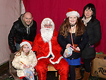 Jessie and Ellie Riggs with parents Ferghal and Carmel pictured with Santa when he paid a visit to Slane. Photo:Colin Bell/pressphotos.ie
