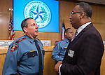 Houston ISD Police Chief Robert Mock, left, talks with Pastor Kenneth Murray, right, following a press conference for Project Safe Start, a collaborative program between area ministers, law enforcement and school officials to encourage students to have a safe summer, May 27, 2014.