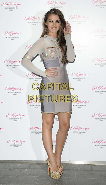Brooke Vincent<br /> attended the Celeb Boutique store launch party, Celeb Boutique, Westfield Stratford  City, London, England, UK, 25th July 2013.<br /> full length grey gray silver dress colour block gold shoes christian louboutin platform heels beaded studded sparkly hand on hip touching hair long sleeve <br /> CAP/CAN<br /> &copy;Can Nguyen/Capital Pictures