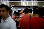 Subway in Beijing, China on Thursday, August 7, 2008. The Chinese government has cut the limit of personal vehicles in half during the Olympic Games causing the crowding of public transportation. The city of Beijing is gearing up for the opening ceremonies of the Olympic Games.  Kevin German