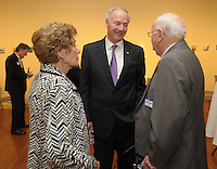NWA Democrat-Gazette/ANDY SHUPE<br /> Gov. Asa Hutchinson (center) speaks Thursday, Oct. 29, 2015, with Clara and Walter Turnbow before the start of the Springdale Public Schools Education Foundation Cornerstone Society induction ceremony at the Arts Center of the Ozarks in Springdale. Visit nwadg.com/photos to see more photographs from the evening.