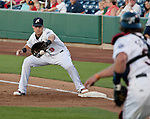 Reno Aces frist basemen Mike Jacobs takes the throw from catcher Konrad Schmidt for the out agianst the Colorado Sky Sox during their game on Wednesday night July 25, 2012 at Aces Ballpark in Reno NV.