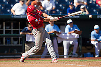 North Carolina State designated hitter Jake Armstrong (23) swings the bat during Game 3 of the 2013 Men's College World Series between the North Carolina State Wolfpack and North Carolina Tar Heels at TD Ameritrade Park on June 16, 2013 in Omaha, Nebraska. The Wolfpack defeated the Tar Heels 8-1. (Andrew Woolley/Four Seam Images)