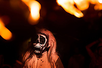 A Salvadoran man, wearing a skull mask, performs an indigenous mythology character during the La Calabiuza parade at the Day of the Dead festivity in Tonacatepeque, El Salvador, 1 November 2016. The festival, known as La Calabiuza since the 90s of the last century, joins Salvador's pre-Hispanic heritage and the mythological figures (La Sihuanaba, El Cipitío, La Llorona etc.) collected from the whole Central American region, together with the catholic All Saints Day holiday and its tradition of honoring the dead relatives. Children and youths only, dressed up in scary costumes and carrying painted carts, march from the local cemetery to the downtown plaza where the party culminates with music, dance, drinking and eating pumpkin (Ayote) with honey.