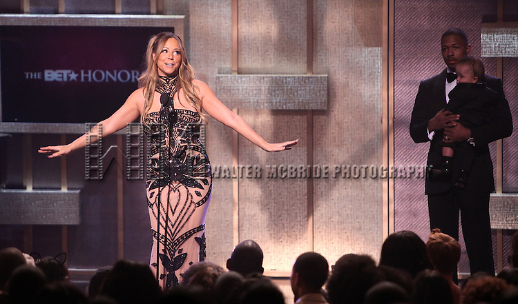 Mariah Carey with Moroccan Scott Cannon & Nick Cannon.onstage during the BET Honors 2012 at the Warner Theatre on January 14, 2012 in Washington, DC.