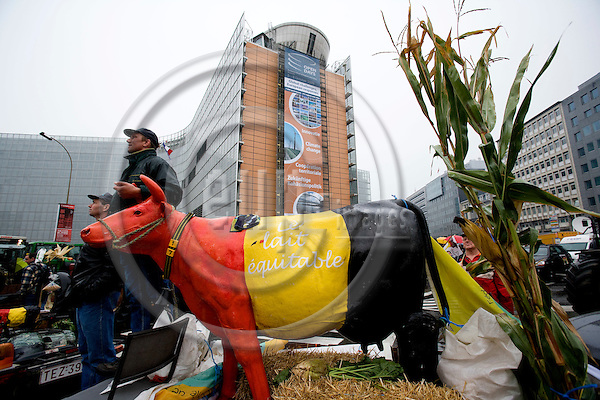 BRUSSELS - BELGIUM - 05 OCTOBER 2009 -- Dairy farmers demonstrating in the EU quarters in Brussels. Here a cow sculpture. In the back the EU Commission.    PHOTO: ERIK LUNTANG / EUP-IMAGES