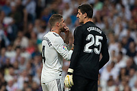 Thibaut Courtois and Sergio Ramos of Real Madrid during the match between Real Madrid v Atletico Madrid of LaLiga, date 7, 2018-2019 season. Santiago Bernabéu Stadium. Madrid, Spain - 29 SEP 2018.