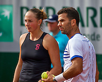 Paris, France, 26 June, 2016, Tennis, Roland Garros, Mixed Doubles:  Jean-Julien Rojer (NED) and his partner Oksana Kalashnikova<br /> Photo: Henk Koster/tennisimages.com