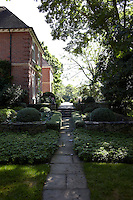 A flagstone path leads from the garden to a raised terrace on one side of the property