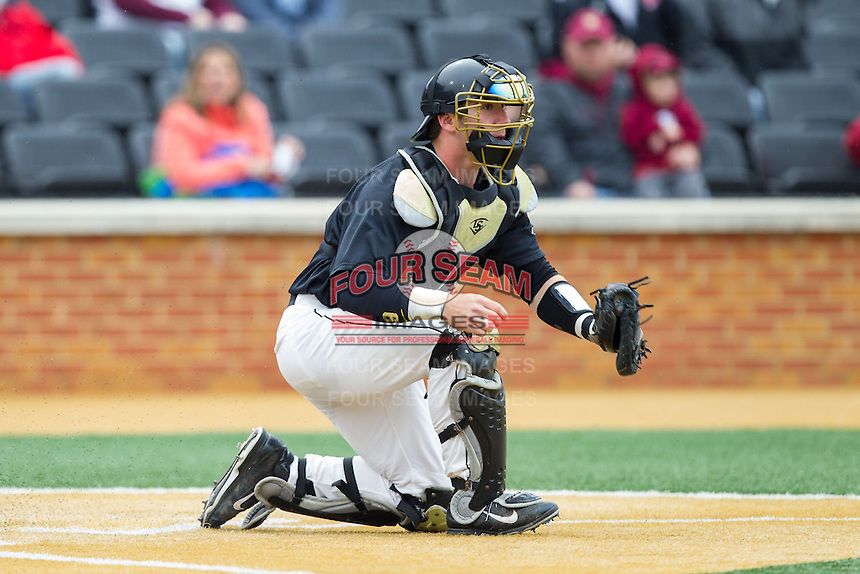 Wake Forest Demon Deacons catcher Ben Breazeale (9) fields a throw at home plate during the game against the Florida State Seminoles at Wake Forest Baseball Park on April 19, 2014 in Winston-Salem, North Carolina.  The Seminoles defeated the Demon Deacons 4-3 in 13 innings.  (Brian Westerholt/Four Seam Images)