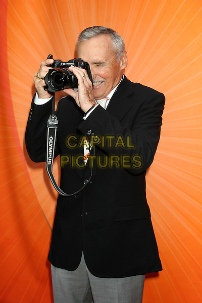 DENNIS HOPPER.2005/2006 NBC UpFront -Arrivals .Rockefeller Center in New York City.May 16th, 2005.half length camera black suit jacket taking photograph gesture.www.capitalpictures.com.sales@capitalpictures.com.©Capital Pictures