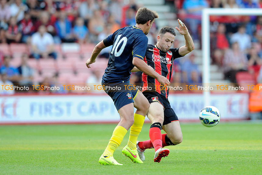 Gaston Ramirez of Southampton is tackled by Marc Pugh of AFC Bournemouth- AFC Bournemouth vs Southampton - Pre-Season Friendly Football Match at the Goldsands Stadium, Kings Park, Boscombe, Bournemouth, Dorset - 25/07/14 - MANDATORY CREDIT: Denis Murphy/TGSPHOTO - Self billing applies where appropriate - contact@tgsphoto.co.uk - NO UNPAID USE