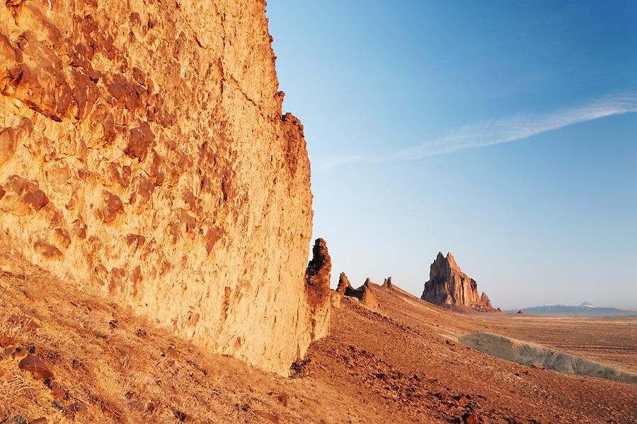 Shiprock Rock and face of dike ridge at sunrise, New Mexico, USA