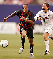 The MetroStars' Ricardo Clark and the Burn's Simo Valakari race to a loose ball. The Dallas Burn defeated the MetroStars 1-0 at Giant's Stadium, East Rutherford, NJ, on August 15, 2004.