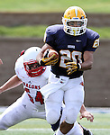 SIOUX FALLS, SD - SEPTEMBER 7:  Dajon Newell #20 from Augustana slips the grasp of Troy Peterson #54 from Minnesota State University Moorhead in the first quarter of their game Saturday at Augustana. (Photo by Dave Eggen/Inertia)