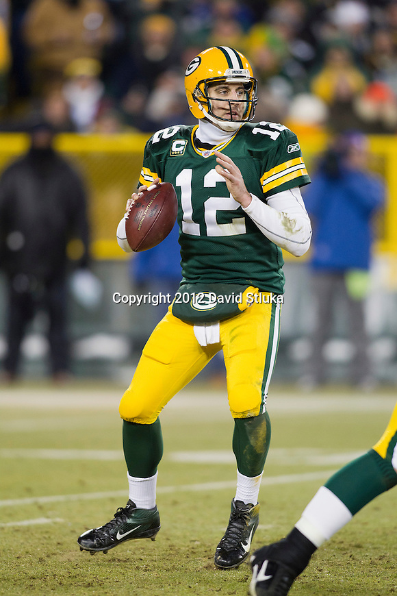 Green Bay Packers quarterback Aaron Rodgers (12) looks for a receiver during an NFL divisional playoff football game against the New York Giants on January 15, 2012 in Green Bay, Wisconsin. The Giants won 37-20. (AP Photo/David Stluka)