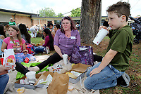 NWA Democrat-Gazette/DAVID GOTTSCHALK  Simon Gulledge (from right), a third grade student at Asbell Elementary School, eats lunch Friday, May 26, 2017, with his aunt Amelia Buford and Pearlie Rutledge, also a third grade student, during the annual Family Picnic at the school in Fayetteville. All grades at the school participated in the event that allowed friends and family to bring a lunch eat outside on the schools property.