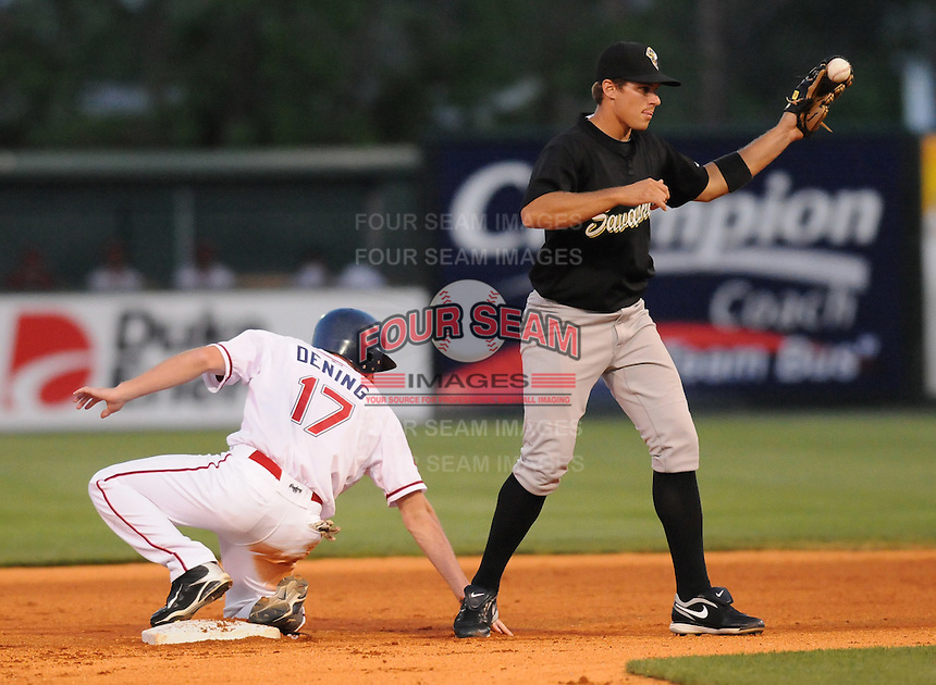 April 30, 2009: Second baseman Jake Eigsti (2) of the Savannah Sand Gnats, shows the umpire he caught the ball for a putout of the Greenville Drive's Mitch Dening (17) at Fluor Field at the West End in Greenville, S.C. Photo by: Tom Priddy/Four Seam Images
