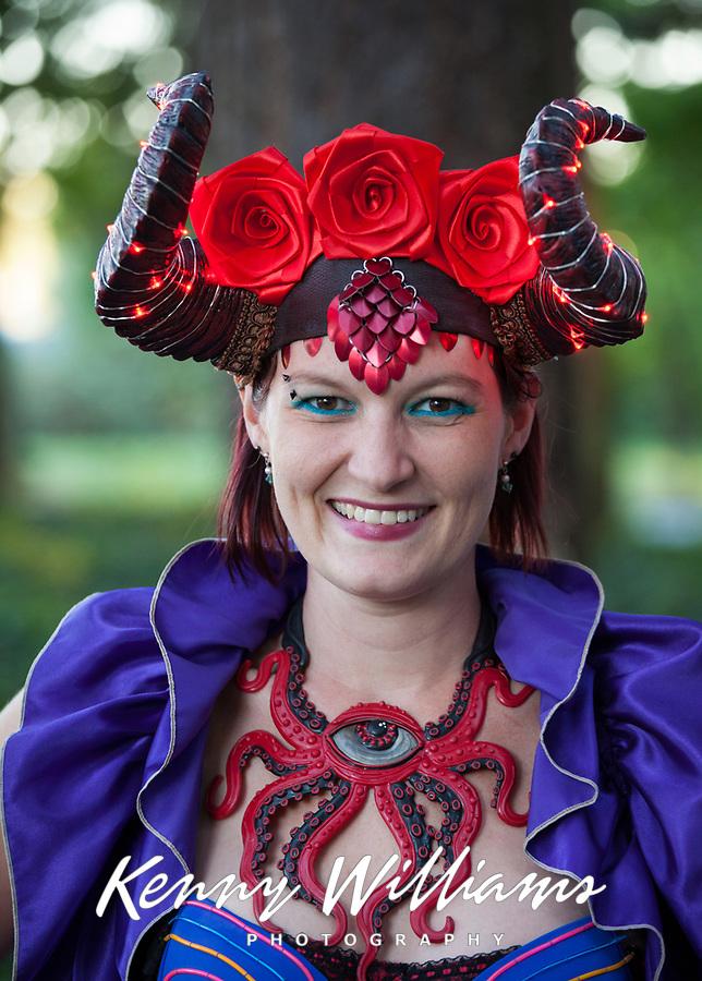 Woman wearing cool costume, Arts A Glow Festival, Dottie Harper Park, Burien, Washington State, WA, America, USA.