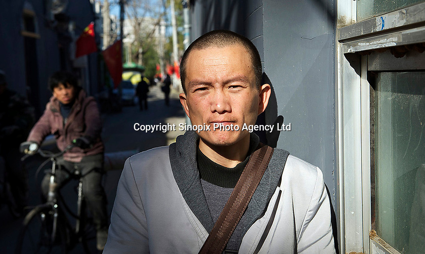 Petitioner Wang Pinghe poses in Beijing, China. Wang, 28, is a farmer who infected HIV and Hepatitis B from a blood transfusion in a local hospital in Runan county, Zhumadian, Henan province, China.<br /> <br /> photo by Lou Lin Wei / Sinopix
