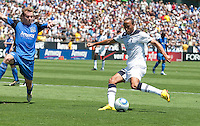Andros Townsend (right) shoots the ball against Chris Leitch (left). San Jose Earthquakes vs Tottenham Hotspur at Buck Shaw Stadium in Santa Clara, California on July 17th, 2010.