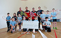 Wednesday 08 January 2014<br /> Pictured: Swansea City Club representatives Lee Trundle and Linden Jones with Peter Crook, Head Coach of Meade Squash club and Children from St.Francis' Catholic School who attend the Squash Club <br /> Re:SwansAid have presented  Meads Squash Club with a cheque for 2000 pounds which they will use to purchase a Squash Ball machine for use in their work with children. It will give a constant consistent feed of balls which totally frees the coach give 100% of tuition time to the children. Their own fundraising has raised £2050 which is half the cost of the machine.