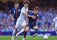 August 10, 2012..Japan's Hotaru Yamaguchi, South Korea's Ji Dong-won in action during bronze medal match at the Millennium Stadium on day fourteen in Cardiff, England. Korea defeat Japan 2-0 to win Olympic bronze medal in men's soccer. ..