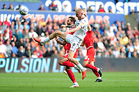 Oli McBurnie of Swansea City battles with Danny Fox of Nottingham Forest during the Sky Bet Championship match between Swansea City and Nottingham Forest at the Liberty Stadium, in Swansea, Wales, UK. Saturday 15 September 2018