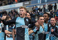 Goalscorer Luke O'Nien of Wycombe Wanderers, Jason McCarthy (left) of Wycombe Wanderers & teammates celebrate the winner during the Sky Bet League 2 match between Wycombe Wanderers and Bristol Rovers at Adams Park, High Wycombe, England on 27 February 2016. Photo by Kevin Prescod.