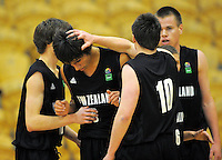 NZ's Max Williams congratulates Reuben Terangi. 2010 FIBA Oceania U18 Championship - NZ Junior Tall Blacks v Australian Emus at Arena Manawatu, Palmerston North on Friday, 17 September 2010. Photo: Dave Lintott/lintottphoto.co.nz