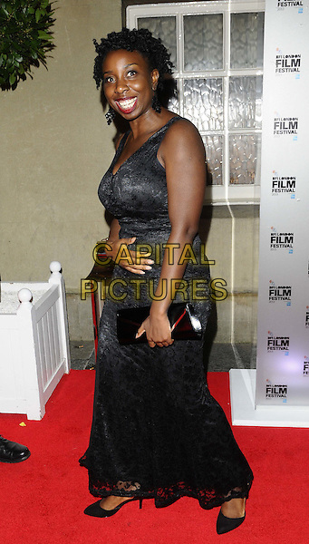 Destiny Ekaragha<br /> attended the BFI London Film Festival Awards 2013, 57th BFI London Film Festival day 11, Banqueting House, Whitehall, London, England, UK, 19th October 2013.<br /> full length black dress hand long maxi clutch bag <br /> CAP/CAN<br /> &copy;Can Nguyen/Capital Pictures