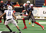 SIOUX FALLS, SD - JUNE 7 Martevious Young #1 from the Sioux Falls Storm looks for running room past Danny Mason #21 from the Texas Revolution in the first quarter of their game Saturday night at the Sioux Falls Arena. (Photo by Dave Eggen/Inertia)